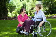 caregiver and senior on a wheelchair